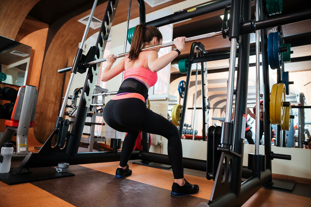 Perform Squats And Overhead Press Using Power Rack